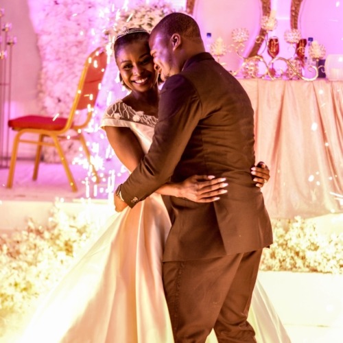 man-in-black-suit-and-woman-in-white-wedding-gown-dancing-2074911